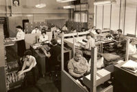 Office_with_typewriters_and_adding_machines